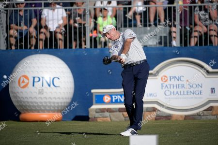 Jim Furyk tees off on the first hole during the first round of the Father Son Challenge golf tournament, in Orlando, Fla