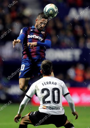Levante UD's Jorge Miramon (L) in action against Valencia FC's Ferran Torres (R) during a Spanish LaLiga soccer match between Levante UD and Valenca FC at the Ciudad de Valencia stadium in Valencia, eastern Spain, 07 December 2019.