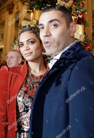"""Rapper Marracash is flanked by his partner singer Elodie as they arrive for the gala premiere of La Scala opera house, in Milan, Italy,. Milan's storied La Scala opens its 2019-2020 season on Saturday with Puccini's """"Tosca,"""" which stars Russian soprano Anna Netrebko as the object of unwanted sexual attention from a powerful authority figure"""