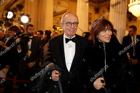 """Pier Carlo Padoan is flanked by his wife Maria Grazia arrive for the gala premiere of La Scala opera house, in Milan, Italy,. Milan's storied La Scala opens its 2019-2020 season on Saturday with Puccini's """"Tosca,"""" which stars Russian soprano Anna Netrebko as the object of unwanted sexual attention from a powerful authority figure"""