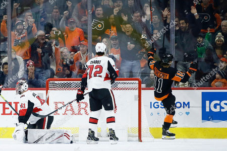 Travis Konecny, Thomas Chabot, Craig Anderson. Philadelphia Flyers' Travis Konecny, right, celebrates after scoring against Ottawa Senators' Craig Anderson left, and Thomas Chabot during the first period of an NHL hockey game, in Philadelphia