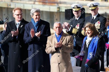 Caroline Kennedy, daughter of former President John F. Kennedy, right, is welcomed on stage by Actin Secretary of the Navy, Thomas Moldy, left, former Secretary of State John Kerry, second form left, and retired Major gen. Charles Bolden, second from right, during ceremonies to christen the nuclear aircraft carrier John F. Kennedy at Newport News Shipbuilding in Newport News, Va