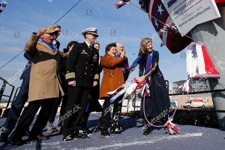 Stock Image of Caroline Kennedy, right, daughter of former President John F. Kennedy, reacts after she smashed a bottle on the bow of the ship as she christens the nuclear aircraft carrier John F. Kennedy at Newport News Shipbuilding in Newport News, Va