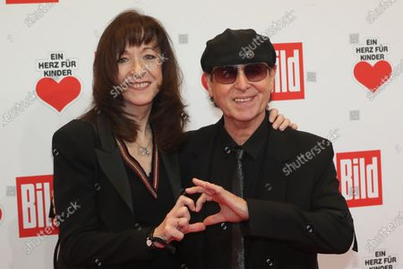Klaus Meine (R) of the band 'Scorpions' and his wife Gabi (L) pose for the media on the red carpet of the 'Ein Herz Fuer Kinder' (lit: A Heart for Children) gala show in Berlin, Germany, 07 December 2019. German television channel ZDF and newspaper 'Bild' with their charity even collect donations for children's charity organizations in Germany and the whole world.
