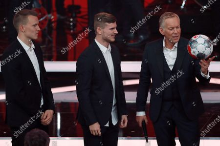 (L-R) RB Leipzig soccer players Lukas Klostermann and Timo Werner with German TV presenter Johannes Baptist Kerner during the 'Ein Herz Fuer Kinder' (lit: A Heart for Children) gala show in Berlin, Germany, 07 December 2019. German television channel ZDF and newspaper 'Bild' collected donations for children's charity organizations in Germany and the whole world.