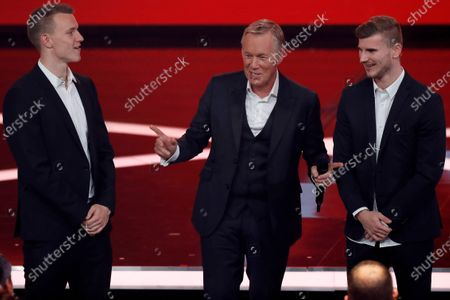 (L-R) RB Leipzig soccer player Lukas Klostermann, German TV presenter Johannes Baptist Kerner and RB Leipzig soccer player Timo Werner during the 'Ein Herz Fuer Kinder' (lit: A Heart for Children) gala show in Berlin, Germany, 07 December 2019. German television channel ZDF and newspaper 'Bild' collected donations for children's charity organizations in Germany and the whole world.