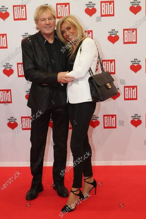Stock Picture of Bernhard Brink (L) and his wife Ute (R) pose for the media on the red carpet of the 'Ein Herz Fuer Kinder' (lit: A Heart for Children) gala show in Berlin, Germany, 07 December 2019. German television channel ZDF and newspaper 'Bild' with their charity even collect donations for children's charity organizations in Germany and the whole world.