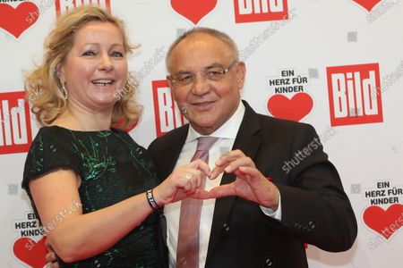 Former German soccer coach Felix Magath (R) and his wife Nicola (L) pose for the media on the red carpet of the 'Ein Herz Fuer Kinder' (lit: A Heart for Children) gala show in Berlin, Germany, 07 December 2019. German television channel ZDF and newspaper 'Bild' with their charity even collect donations for children's charity organizations in Germany and the whole world.