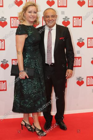 Stock Image of Former German soccer coach Felix Magath (R) and his wife Nicola (L) pose for the media on the red carpet of the 'Ein Herz Fuer Kinder' (lit: A Heart for Children) gala show in Berlin, Germany, 07 December 2019. German television channel ZDF and newspaper 'Bild' with their charity even collect donations for children's charity organizations in Germany and the whole world.