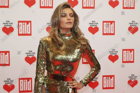 Sophia Thomalla poses for the media on the red carpet of the 'Ein Herz Fuer Kinder' (lit: A Heart for Children) gala show in Berlin, Germany, 07 December 2019. German television channel ZDF and newspaper 'Bild' with their charity even collect donations for children's charity organizations in Germany and the whole world.