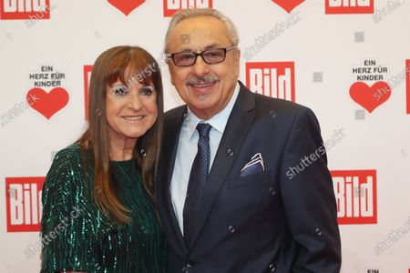 Stock Image of Wolfgang Stumph (R) and his wife Christine (L) pose for the media on the red carpet of the 'Ein Herz Fuer Kinder' (lit: A Heart for Children) gala show in Berlin, Germany, 07 December 2019. German television channel ZDF and newspaper 'Bild' with their charity even collect donations for children's charity organizations in Germany and the whole world.