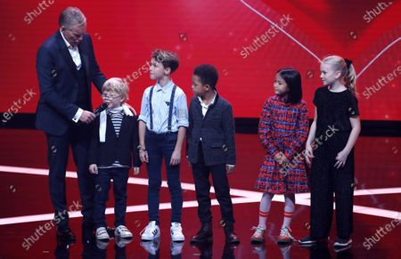Stock Image of Johannes Baptist Kerner (L) talks to children during the 'Ein Herz Fuer Kinder' (lit: A Heart for Children) gala show in Berlin, Germany, 07 December 2019. German television channel ZDF and newspaper 'Bild' collected donations for children's charity organizations in Germany and the whole world.