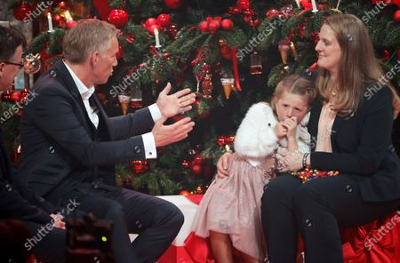 Stock Photo of Johannes Baptist Kerner (2-L) talks to speaks with Lara and her mother Michaela Wienbrandt during the 'Ein Herz Fuer Kinder' (lit: A Heart for Children) gala show in Berlin, Germany, 07 December 2019. German television channel ZDF and newspaper 'Bild' collected donations for children's charity organizations in Germany and the whole world.