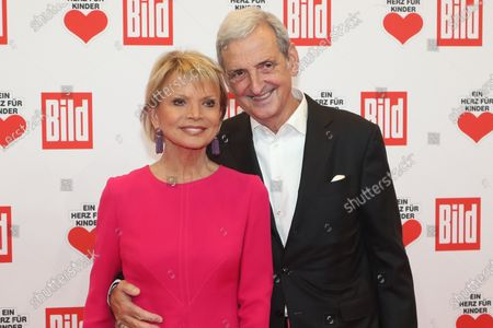 Uschi Glas (L) and her partner Dieter Hermann (R) pose for the media on the red carpet of the 'Ein Herz Fuer Kinder' (lit: A Heart for Children) gala show in Berlin, Germany, 07 December 2019. German television channel ZDF and newspaper 'Bild' with their charity even collect donations for children's charity organizations in Germany and the whole world.