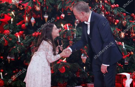 Johannes Baptist Kerner (R) talks to American-Jordanian singer Emanne Beasha (L) during the 'Ein Herz Fuer Kinder' (lit: A Heart for Children) gala show in Berlin, Germany, 07 December 2019. German television channel ZDF and newspaper 'Bild' collected donations for children's charity organizations in Germany and the whole world.