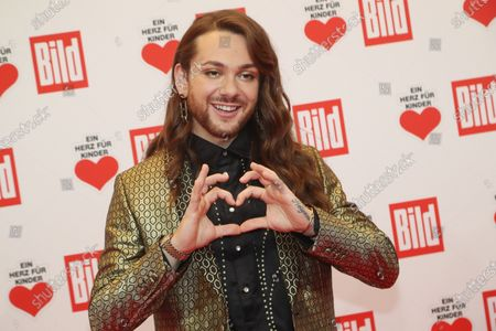 Stock Image of Riccardo Simonetti poses for the media on the red carpet of the 'Ein Herz Fuer Kinder' (lit: A Heart for Children) gala show in Berlin, Germany, 07 December 2019. German television channel ZDF and newspaper 'Bild' with their charity even collect donations for children's charity organizations in Germany and the whole world.