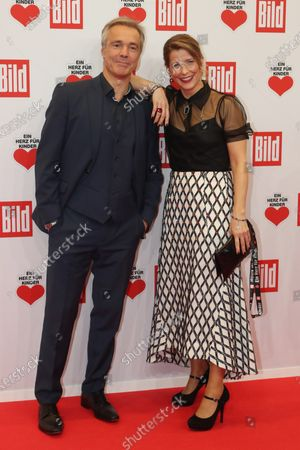 Hannes Jaenicke (L) and an unidentified guest pose for the media on the red carpet of the 'Ein Herz Fuer Kinder' (lit: A Heart for Children) gala show in Berlin, Germany, 07 December 2019. German television channel ZDF and newspaper 'Bild' with their charity even collect donations for children's charity organizations in Germany and the whole world.