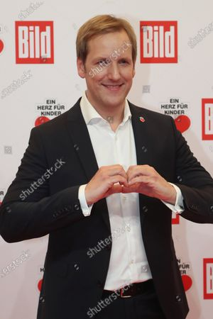 Stock Image of German TV presenter Jan Hahn poses for the media on the red carpet of the 'Ein Herz Fuer Kinder' (lit: A Heart for Children) gala show in Berlin, Germany, 07 December 2019. German television channel ZDF and newspaper 'Bild' with their charity even collect donations for children's charity organizations in Germany and the whole world.