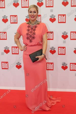 Stock Image of German TV presenter Ruth Moschner poses for the media on the red carpet of the 'Ein Herz Fuer Kinder' (lit: A Heart for Children) gala show in Berlin, Germany, 07 December 2019. German television channel ZDF and newspaper 'Bild' with their charity even collect donations for children's charity organizations in Germany and the whole world.
