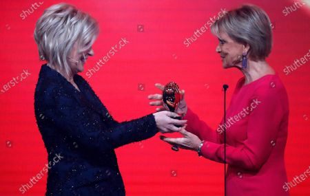 German actress Uschi Glas (R) receives the Golden Heart Award from German TV presenter Carmen Nebel (L) during the 'Ein Herz Fuer Kinder' (lit: A Heart for Children) gala show in Berlin, Germany, 07 December 2019. German television channel ZDF and newspaper 'Bild' collected donations for children's charity organizations in Germany and the whole world.