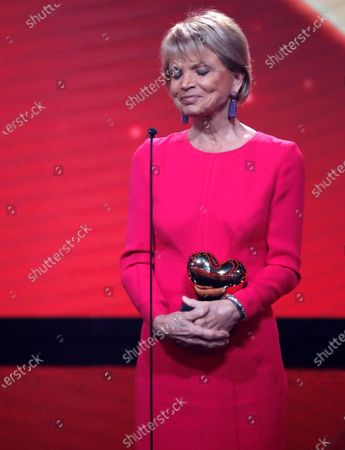 German actress Uschi Glas speaks after receiving the Golden Heart Award during the 'Ein Herz Fuer Kinder' (lit: A Heart for Children) gala show in Berlin, Germany, 07 December 2019. German television channel ZDF and newspaper 'Bild' collected donations for children's charity organizations in Germany and the whole world.
