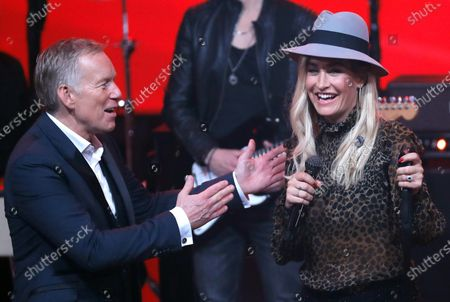 Johannes B. Kerner (L) speaks with German singer Sarah Connor (R) during the 'Ein Herz Fuer Kinder' (lit: A Heart for Children) gala show in Berlin, Germany, 07 December 2019. German television channel ZDF and newspaper 'Bild' collected donations for children's charity organizations in Germany and the whole world.