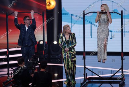 German entertainer Barbara Schoeneberger (C) and guests perform during the 'Ein Herz Fuer Kinder' (lit: A Heart for Children) gala show in Berlin, Germany, 07 December 2019. German television channel ZDF and newspaper 'Bild' collected donations for children's charity organizations in Germany and the whole world.