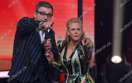 German actor Hans Sigl and German entertainer Barbara Schoeneberger (R) joke around during the 'Ein Herz Fuer Kinder' (lit: A Heart for Children) gala show in Berlin, Germany, 07 December 2019. German television channel ZDF and newspaper 'Bild' collected donations for children's charity organizations in Germany and the whole world.