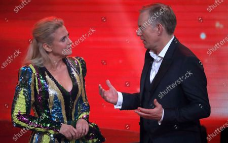 Johannes B. Kerner (R) speaks with German entertainer Barbara Schoeneberger (L) during the 'Ein Herz Fuer Kinder' (lit: A Heart for Children) gala show in Berlin, Germany, 07 December 2019. German television channel ZDF and newspaper 'Bild' collected donations for children's charity organizations in Germany and the whole world.