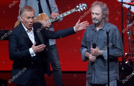 Stock Image of Johannes B. Kerner (L) speaks with German singer Wolfgang Petry (R) during the 'Ein Herz Fuer Kinder' (lit: A Heart for Children) gala show in Berlin, Germany, 07 December 2019. German television channel ZDF and newspaper 'Bild' collected donations for children's charity organizations in Germany and the whole world.