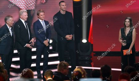 Lena Palm (R) receives the honorary prize from former German Formula 1 driver Nico Rosberg (C), former German tennis player Boris Becker (2-L) and former boxing world heavyweight champion Ukrainian Wladimir Klitschko (2-R) during the 'Ein Herz Fuer Kinder' (lit: A Heart for Children) gala show in Berlin, Germany, 07 December 2019. German television channel ZDF and newspaper 'Bild' collected donations for children's charity organizations in Germany and the whole world.