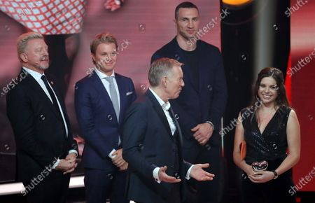 Lena Palm (R) receives the honorary prize from former German Formula 1 driver Nico Rosberg (2-L), former German tennis player Boris Becker (L) and former boxing world heavyweight champion Ukrainian Wladimir Klitschko (2-R) during the 'Ein Herz Fuer Kinder' (lit: A Heart for Children) gala show in Berlin, Germany, 07 December 2019. German television channel ZDF and newspaper 'Bild' collected donations for children's charity organizations in Germany and the whole world.