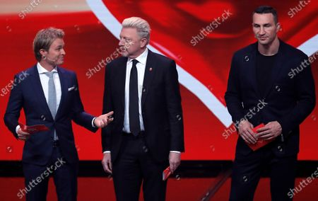 Former German Formula 1 driver Nico Rosberg (L), former German tennis player Boris Becker (C) and former boxing world heavyweight champion, Ukrainian Wladimir Klitschko speak on stage during the 'Ein Herz Fuer Kinder' (lit: A Heart for Children) gala show in Berlin, Germany, 07 December 2019. German television channel ZDF and newspaper 'Bild' collected donations for children's charity organizations in Germany and the whole world.