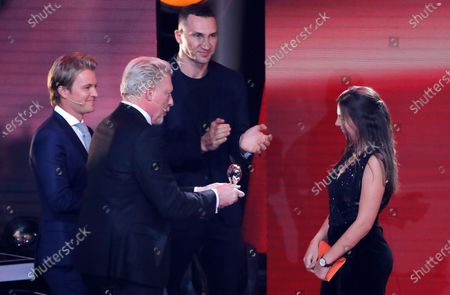 Lena Palm (R) receives the honorary prize from former German Formula 1 driver Nico Rosberg (L), former German tennis player Boris Becker (2-L) and former boxing world heavyweight champion Ukrainian Wladimir Klitschko (2-R) during the 'Ein Herz Fuer Kinder' (lit: A Heart for Children) gala show in Berlin, Germany, 07 December 2019. German television channel ZDF and newspaper 'Bild' collected donations for children's charity organizations in Germany and the whole world.