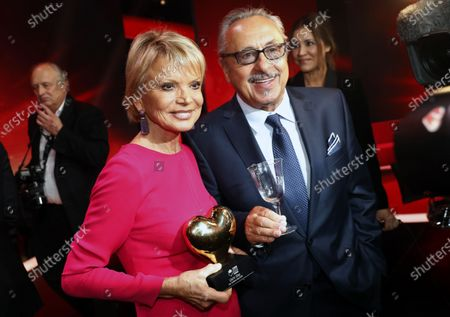 German actor Wolfgang Stumph (R) and German actress Uschi Glas (L) with her award after the Ein Herz Fuer Kinder Gala show in Berlin, Germany, 07 December 2019. German television channel ZDF and newspaper 'Bild' collected donations for children's charity organizations in Germany and globally.