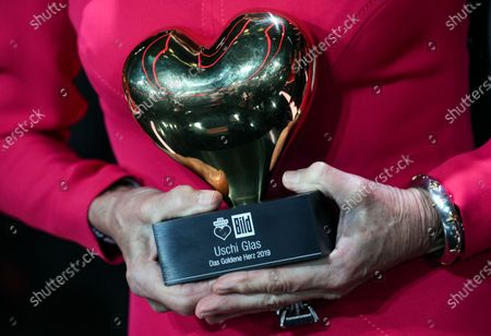 German actress Uschi Glas poses with her award after the Ein Herz Fuer Kinder Gala show in Berlin, Germany, 07 December 2019. German television channel ZDF and newspaper 'Bild' collected donations for children's charity organizations in Germany and globally.