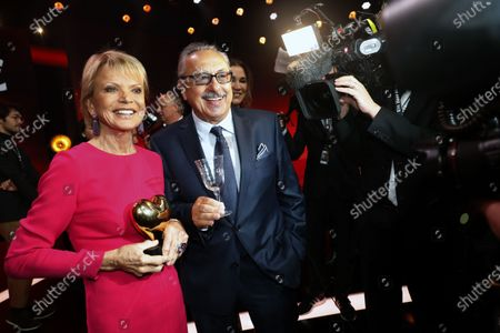 Stock Photo of German actor Wolfgang Stumph (C) and German actress Uschi Glas (L) with her award after the Ein Herz Fuer Kinder Gala show in Berlin, Germany, 07 December 2019. German television channel ZDF and newspaper 'Bild' collected donations for children's charity organizations in Germany and globally.