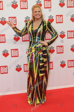 Barbara Schoeneberger poses for the media on the red carpet of the 'Ein Herz Fuer Kinder' (lit: A Heart for Children) gala show in Berlin, Germany, 07 December 2019. German television channel ZDF and newspaper 'Bild' with their charity even collect donations for children's charity organizations in Germany and the whole world.