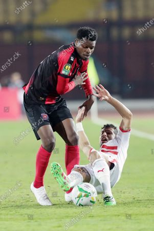 Zamalek  player Tarek Hamed  (R) in action against Primeiro De Agosto player Natael Paulo (L) during the CAF Champions League soccer match between Zamalek and Primeiro De Agosto at Al-Salam Stadium in Cairo, Egypt, 07 December 2019.
