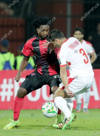 Zamalek player Tarek Hamed  (R) in action against Primeiro De Agosto player Cristovao Paciencia (L) during the CAF Champions League soccer match between Zamalek and Primeiro De Agosto at Al-Salam Stadium in Cairo, Egypt, 07 December 2019.