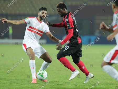 Zamalek player Ferjani Sassi (L) in action against Primeiro De Agosto player Manuel Afonso (R) during the CAF Champions League soccer match between Zamalek and Primeiro De Agosto at Al-Salam Stadium in Cairo, Egypt, 07 December 2019.