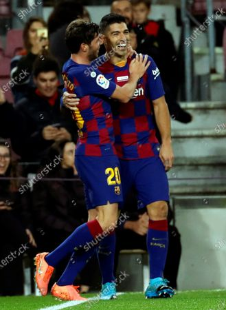FC Barcelona's striker Luis Suarez (R) celebrates with Sergi Roberto (L) after scoring the fourth goal during a Spanish LaLiga soccer match between FC Barcelona and RCD Mallorca at Camp Nou stadium in Barcelona, northeastern Spain, 07 December 2019.