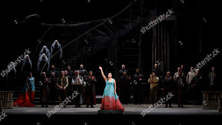 """Russian soprano Anna Netrebko acknowledges the applause of the audience at the end of La Scala opera house's gala season opener, Giacomo Puccini's opera """"Tosca"""" at the Milan La Scala theater, Italy,. The season-opener Thursday, held each year on the Milan feast day St. Ambrose, is considered one of the highlights of the European cultural calendar"""