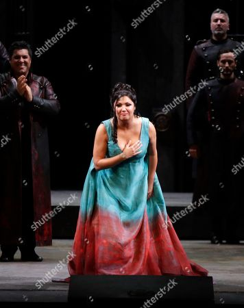 """Russian soprano Anna Netrebko bows to the audience at the end of La Scala opera house's gala season opener, Giacomo Puccini's opera """"Tosca"""" at the Milan La Scala theater, Italy, . The season-opener Thursday, held each year on the Milan feast day St. Ambrose, is considered one of the highlights of the European cultural calendar"""