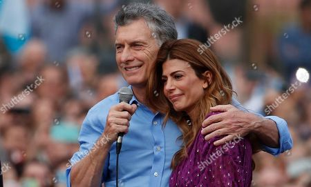 """Argentina's President Mauricio Macri and his wife Juliana Awada react during a rally in support of Macri, in Buenos Aires, Argentina, . Despite losing to opposition candidate Alberto Fernandez in the recent presidential elections the conservative leader garnered 40 percent of the vote and his """"Let's Change"""" political movement look set to continue being an ongoing force in Argentine politics"""