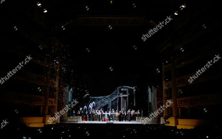 """Russian soprano Anna Netrebko and all the cast acknowledge the applause of the audience at the end of La Scala opera house's gala season opener, Giacomo Puccini's opera """"Tosca"""" at the Milan La Scala theater, Italy, . The season-opener Thursday, held each year on the Milan feast day St. Ambrose, is considered one of the highlights of the European cultural calendar"""