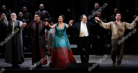 """From left, Alfonso Antoniozzi, Luca Salsi, Anna Netrebko, conductor Riccardo Chailly and Francesco Meli acknowledge the applause of the audience at the end of La Scala opera house's gala season opener, Giacomo Puccini's opera """"Tosca"""" at the Milan La Scala theater, Italy, . The season-opener Thursday, held each year on the Milan feast day St. Ambrose, is considered one of the highlights of the European cultural calendar"""