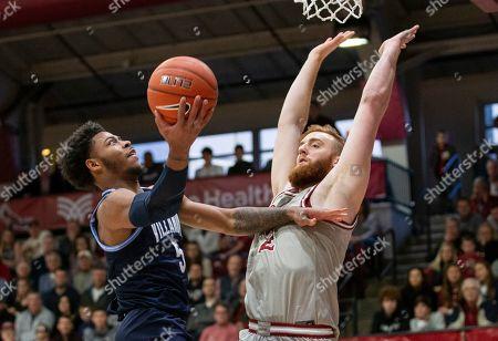 Villanova guard Justin Moore (5) takes a shot over Saint Joseph's forward Myles Douglas (2) in the first half of an NCAA college basketball game, in Philadelphia