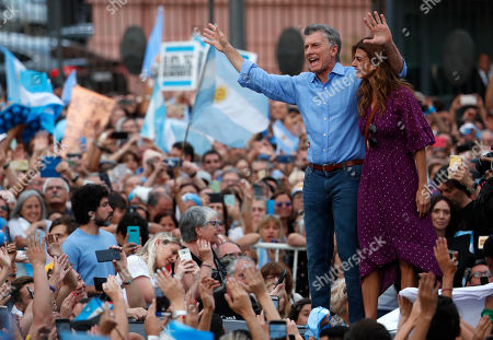 Outgoing Argentine President Mauricio Macri is embraced by his wife and first lady Juliana Awada, during a support rally for Macri in Buenos Aires, Argentina, . Despite losing to opposition candidate Alberto Fernandez in the recent presidential elections the conservative leader Macri garnered 40 percent of the vote and his 'Let's Change' political movement look set to continue being an ongoing force in Argentine politics