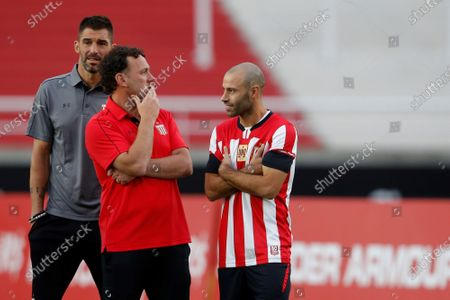 Stock Picture of Soccer player Javier Mascherano (R) speaks with Gabriel Milito (L), coach of Estudiantes de La Plata, during the presentation of Mascherano as a new player of the Argentinian team Estudiantes de La Plata in the stadium Jorge Luis Hirschi in La Plata, Argentina, 07 December 2019.